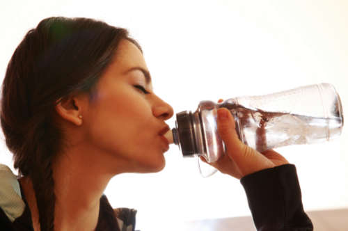 young-fit-woman-drinking-water-at-gym_SFvsLDCBs_2_500_332